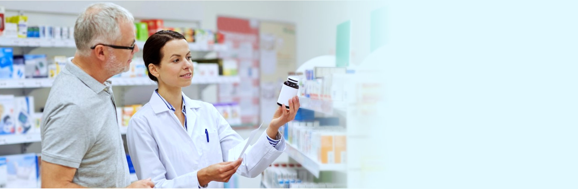 pharmacist and customer readng the label