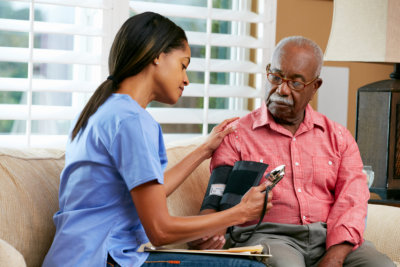 lady checking the old man's blood pressure