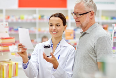 old man talking with the pharmacist